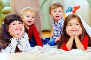group-of-attentive-kids-in-nursery-room
